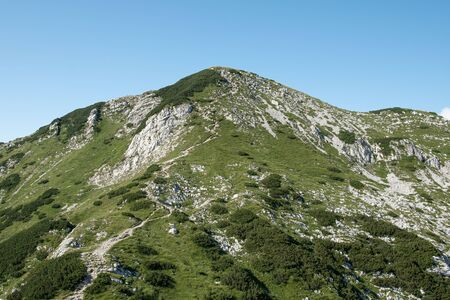 Sija peak during summer in sunny and cloudy day, view from footpath to Sija peak, Julian Alpe