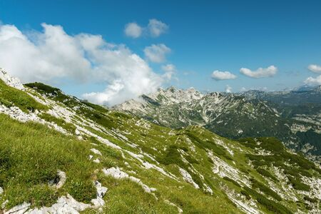 Vogel peak during summer in sunny and cloudy day, view from Sija peak, Julian Alpe