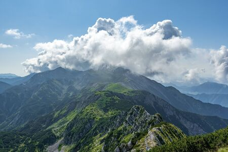 Rodica peak during summer in sunny and cloudy day, view from Sija peak, Julian Alpe