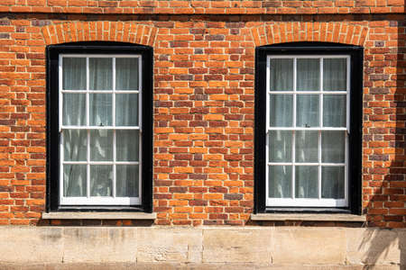 Old bricks wall in England with windows, England