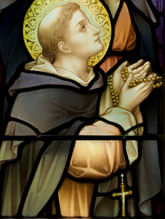Stained glass in Catholic church in Dublin showing a saint deep in a prayer