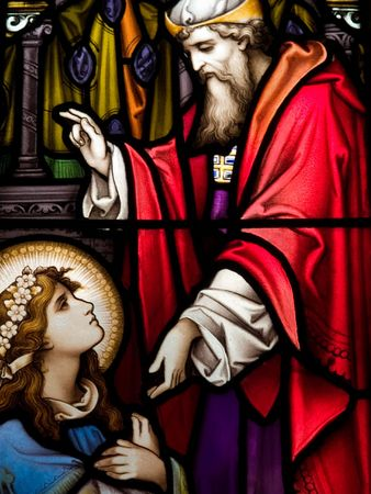 clergyman: Stained glass in Catholic church in Dublin showing a priest giving his blessing The stained-glass windows are by the famous artist, William Early, who died during the commission Stock Photo
