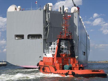 Tugboat: Tugboat assisting huge vessel