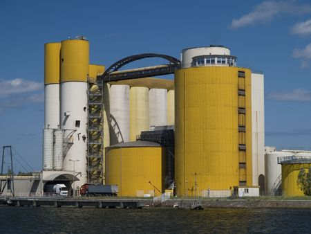 Elevators for malt and grain located beside port canal Stock Photo
