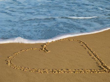Heart drawn on a sandy beach Stock Photo - 4503851