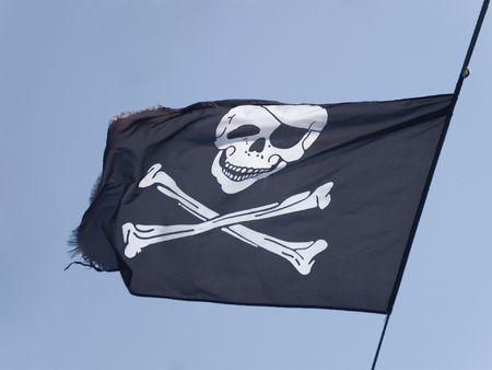 Pirate Flag flying on a blue sky Stock Photo - 8055609