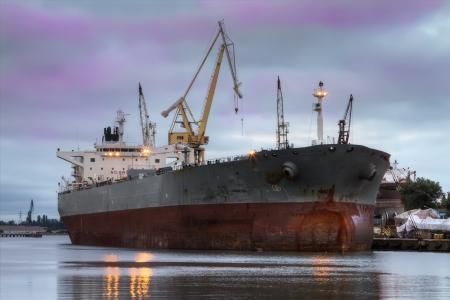 A huge ship in a repair shipyard photo