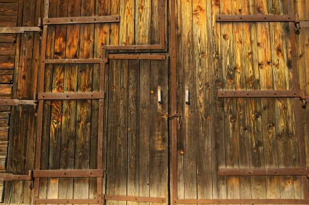 Old wooden gate faded by sun with chain   photo