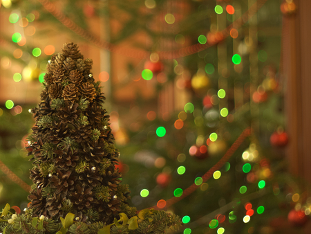 Christmas tree made of cones with fir branches and lights photo