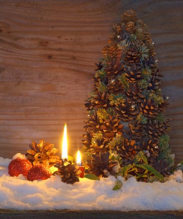 Christmas tree made of cones with fir branches and candy lights photo