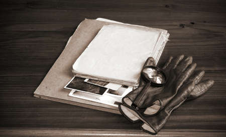Vintage documents with magnifying glass investigation concept Stock Photo