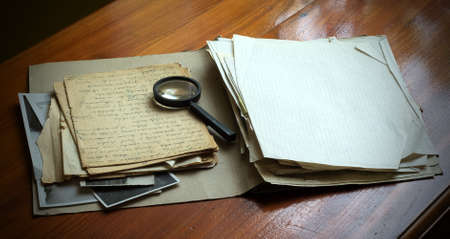 Vintage documents with magnifying glass investigation concept Reklamní fotografie