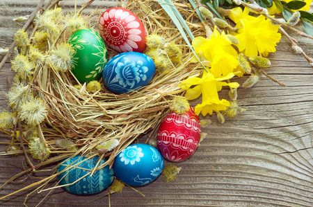 Easter painted eggs on the boards photo