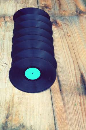 music background: Vinyls with old boards vintage