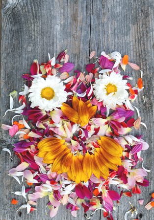 Old boards with flowers and petals vintage smile face concept photo