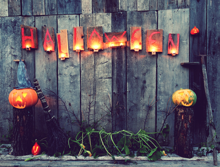 Halloween pumpkins with inscription and wood boards photo