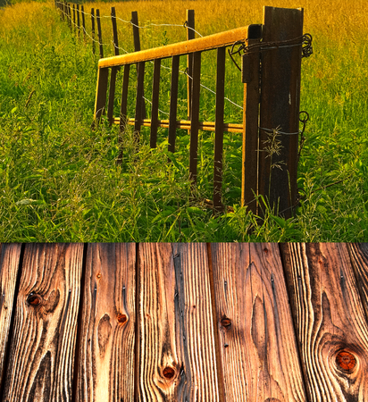 Old metal gate on the farm with light of sunset and boards photo