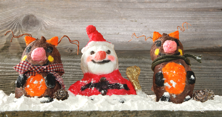 Santa claus with reindeers and gifts holiday background photo
