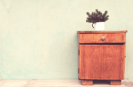 small table: Old cup with fir branches vintage small table concept Stock Photo