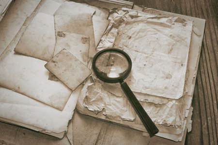 Top secret documents investigation concept background with glass