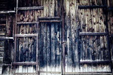 Old wooden rusted doors gate background or texture