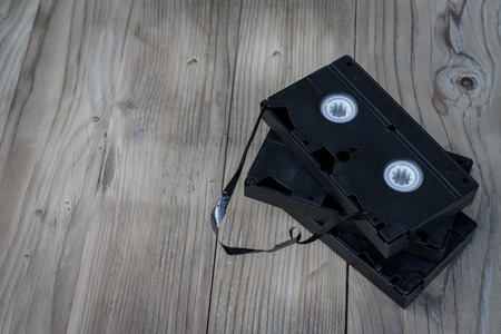 Vintage view with old cassettes vhs video on wooden desk Stock Photo