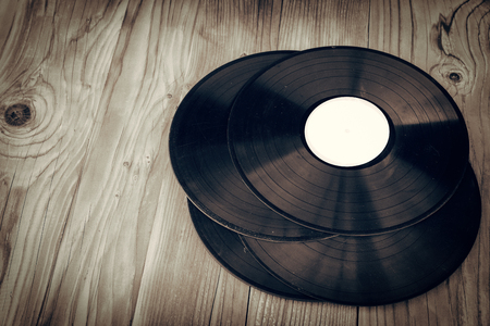 Old vinyls retro style with wooden deck boards Stock Photo