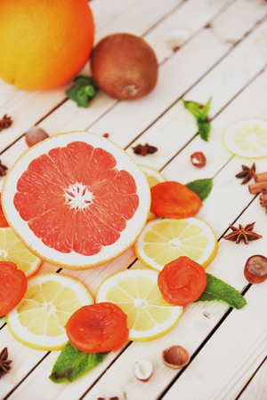 Juicy grapefruit with lemon on a wooden white table close-up. Art soft focus and toned. Stock Photo
