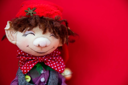 toy rag doll on red background. Art soft focus Stockfoto
