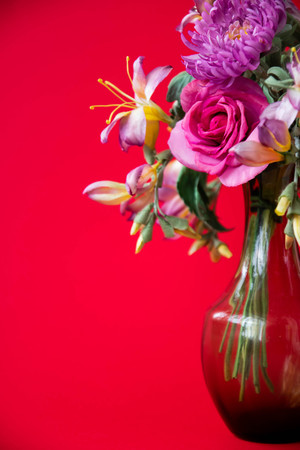 beautiful artificial flowers on red background. Art soft focus