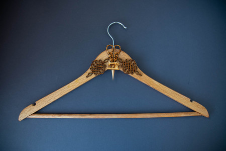 decorative hanger on blue background. Art soft focus. Stock Photo