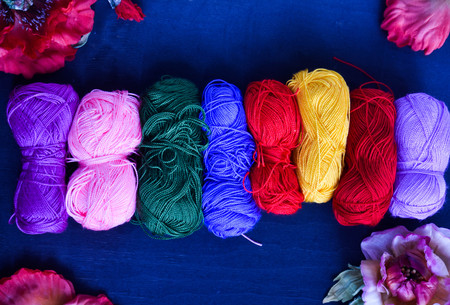 knitting threads on a blue background