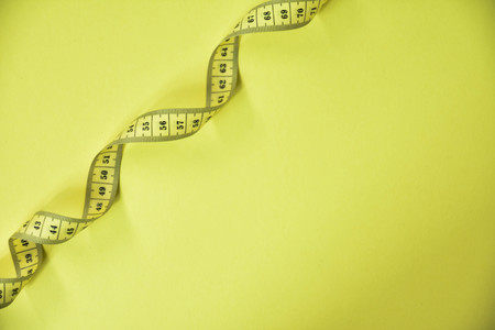 centimeter tape on a yellow background
