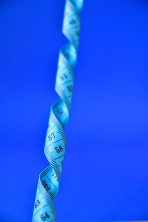 centimeter tape on a blue background. art soft focus