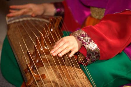 A girl playing guzheng photo