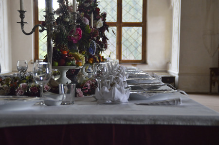 table with food and in the castle in the background window