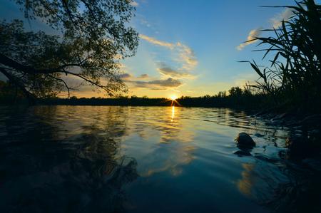 Sunset on the lake Standard-Bild