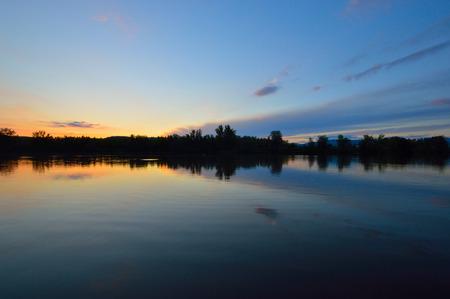 Reflection on the lake after sunset Standard-Bild
