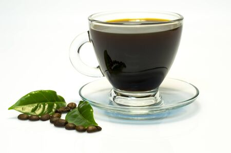 Cup of coffee on a white background with green leaves and coffee beans. Glass cup. 写真素材