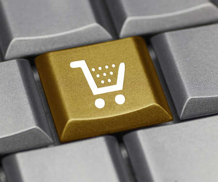 Computer key - shopping cart gold photo