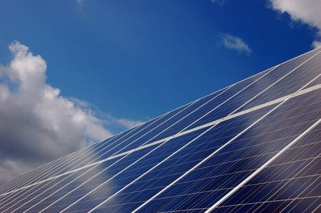 Solar Panels in front of cloudy blue sky  photo