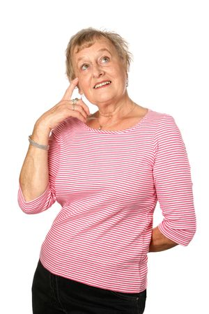 Female senior pointing to her forehead in gesture of thinking or applying common sense, isolated on white background.
