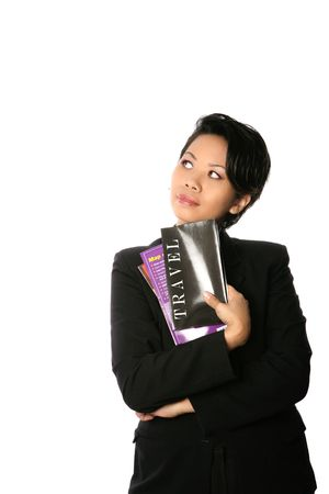 Asian businesswoman with a handful of travel brochures and map thinking up ideas , isolated.