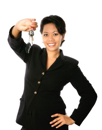 Very happy Asian businesswoman showing off her set of keys, isolated on white. Banque d'images