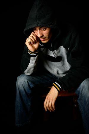 morose: Low key image of young man depressed. Stock Photo
