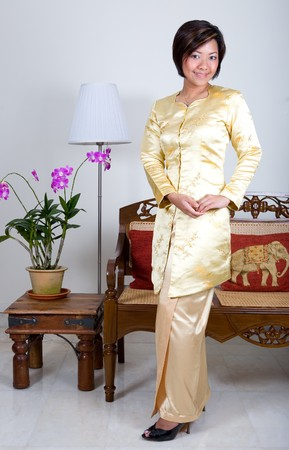 Malay woman in traditional ' Kebaya ' clothing with a modern style
