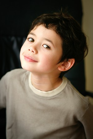 dilate: Happy little boy with brown eyes and beautiful smile.