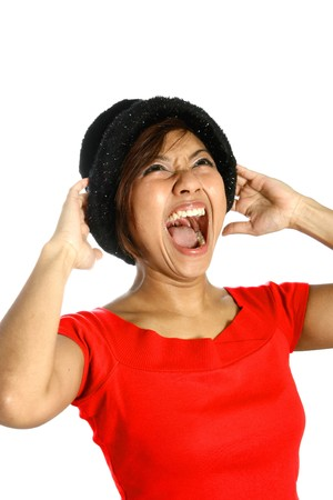 uncontrollable: Young Asian female screaming at the top of her voice, showing her emotion of anger and frustration.