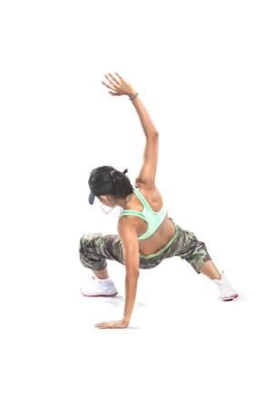 Beautiful female hip hop dancer striking a dance pose. photo