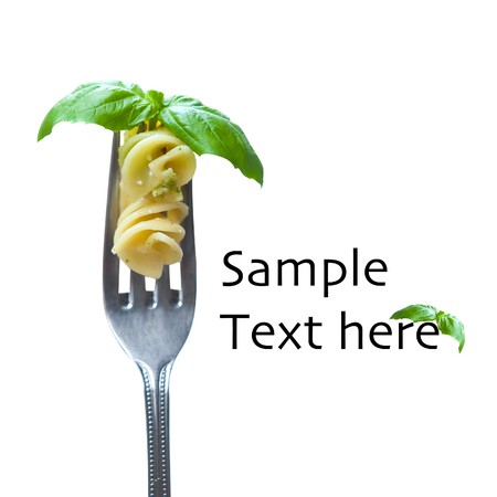 Fork with pasta and basil, isolated Banque d'images